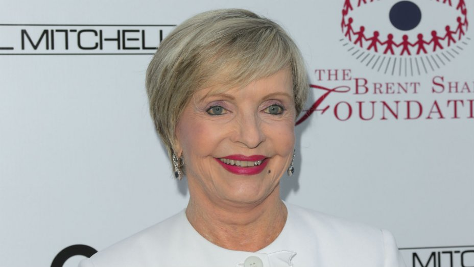 Florence Henderson attends  event in a white attire wearing a slight smile on her face