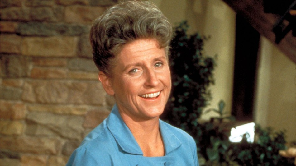 Ann B. Davis is wearing a white colored dress and smile on her face