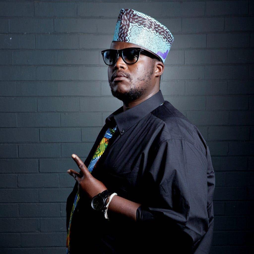 Hip Hop Pantsula wearing a black shirt and African hat