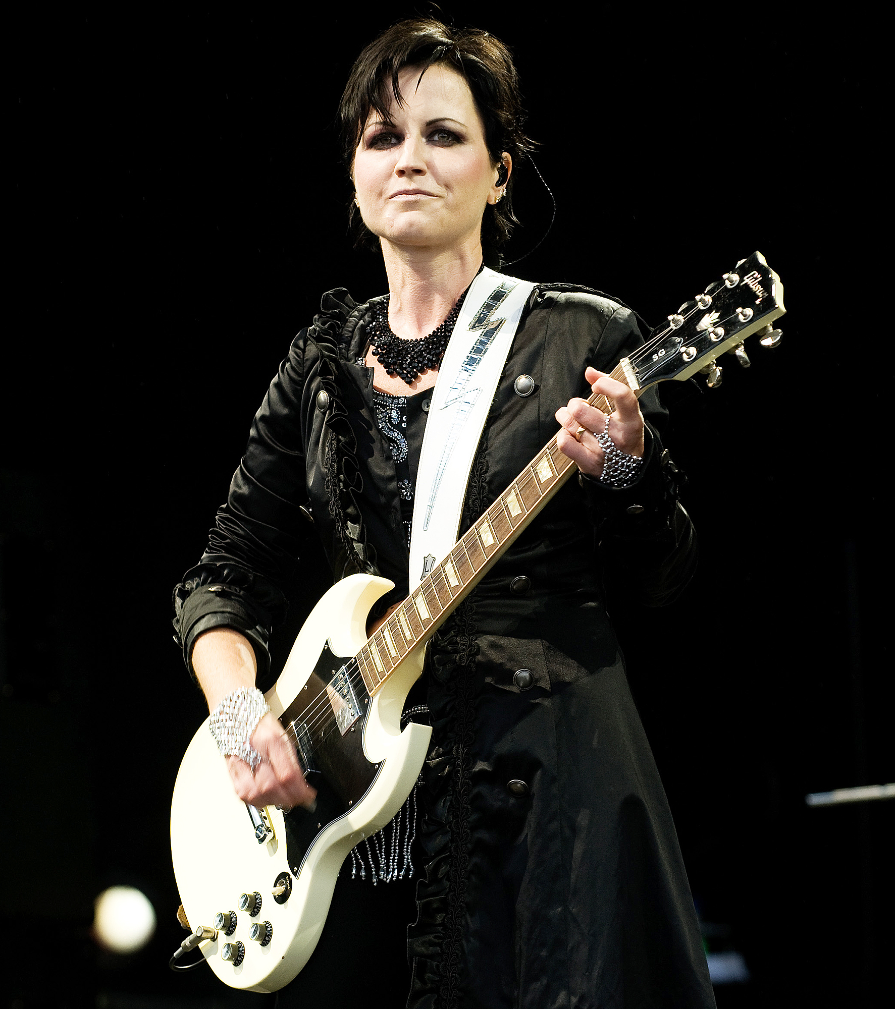 Dolores O'Riordan performing at a stage