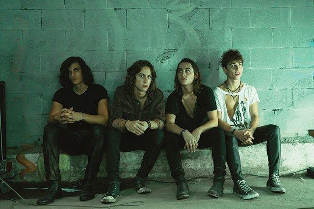 Josh Kiszka, guitarist Jake Kiszka, bassist Sam Kiszka and drummer Danny Wagner sitting