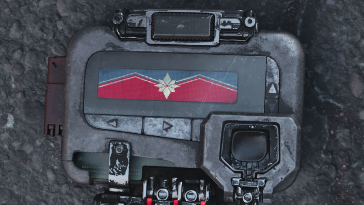Pager with pixelated version of captain marvel sign from last scene of avengers infinity war
