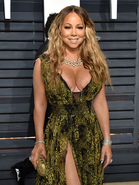 Mariah Carey smiling for a photo