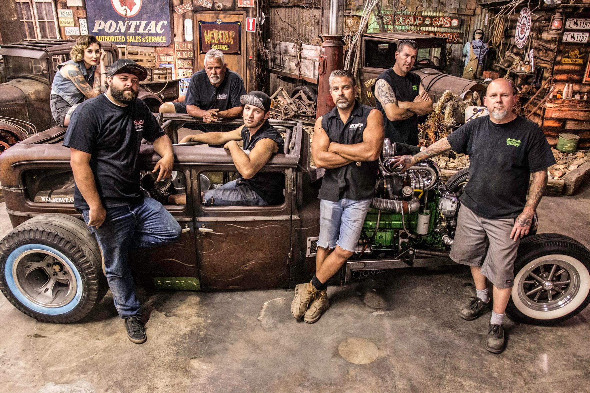 Cast of the Vegas Rat Rods posing for picture in their workshop