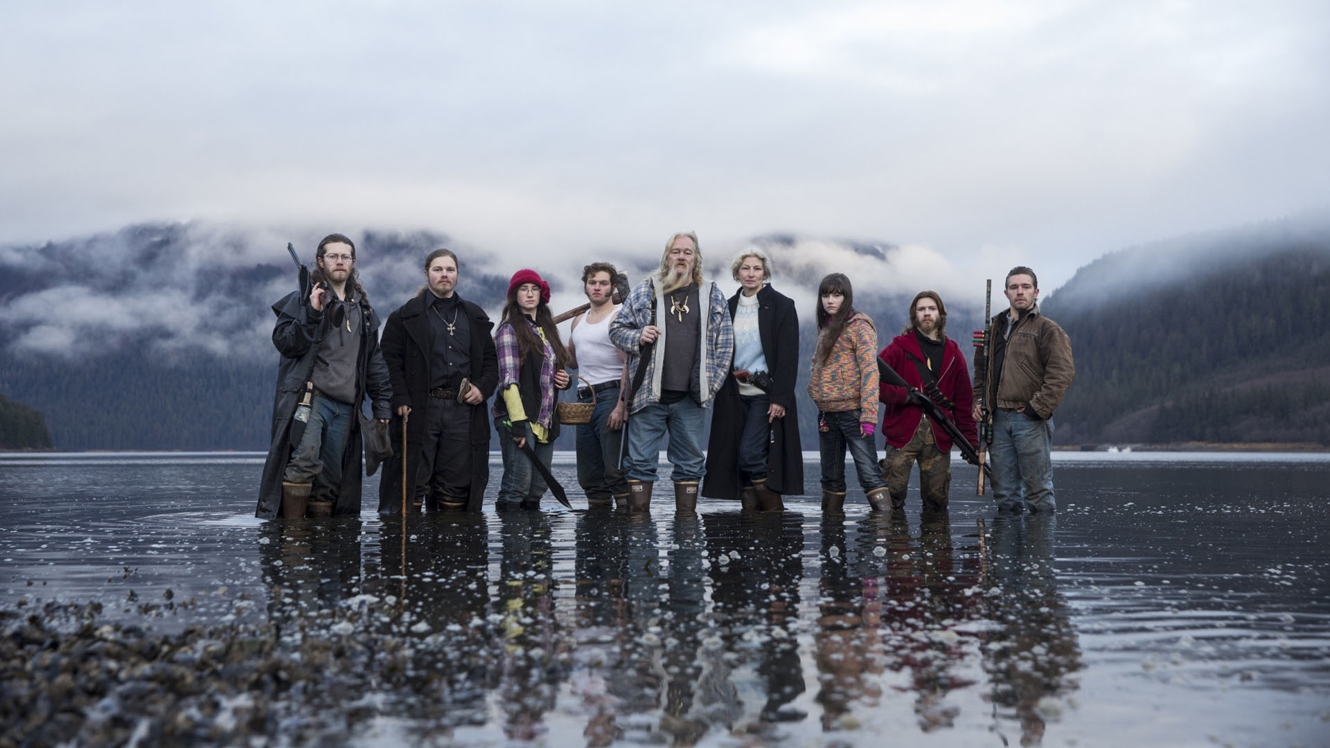 Brown Family posong for the cover of the Alaskan Bush People