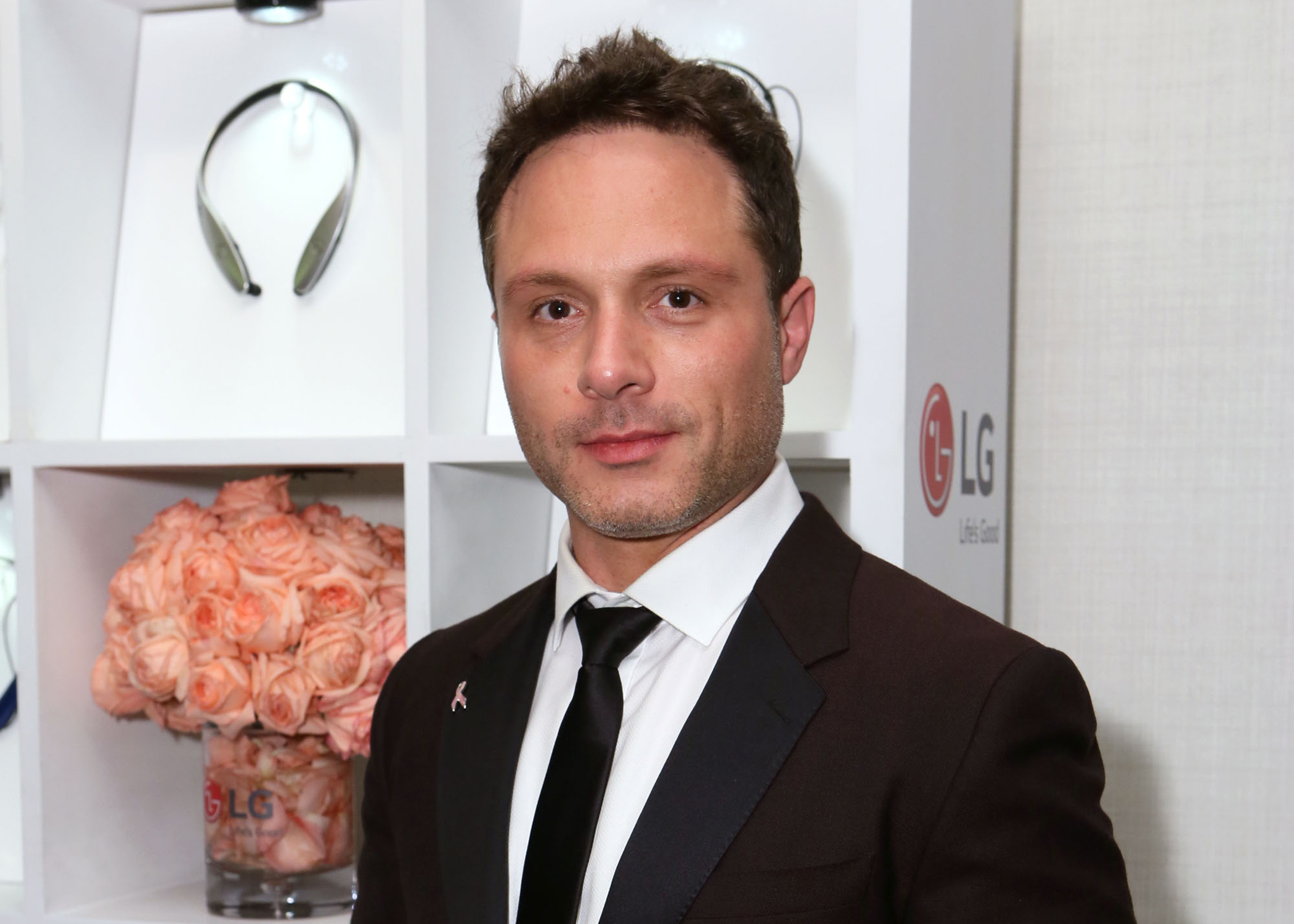 Nic Pizzolatto wearing a suit