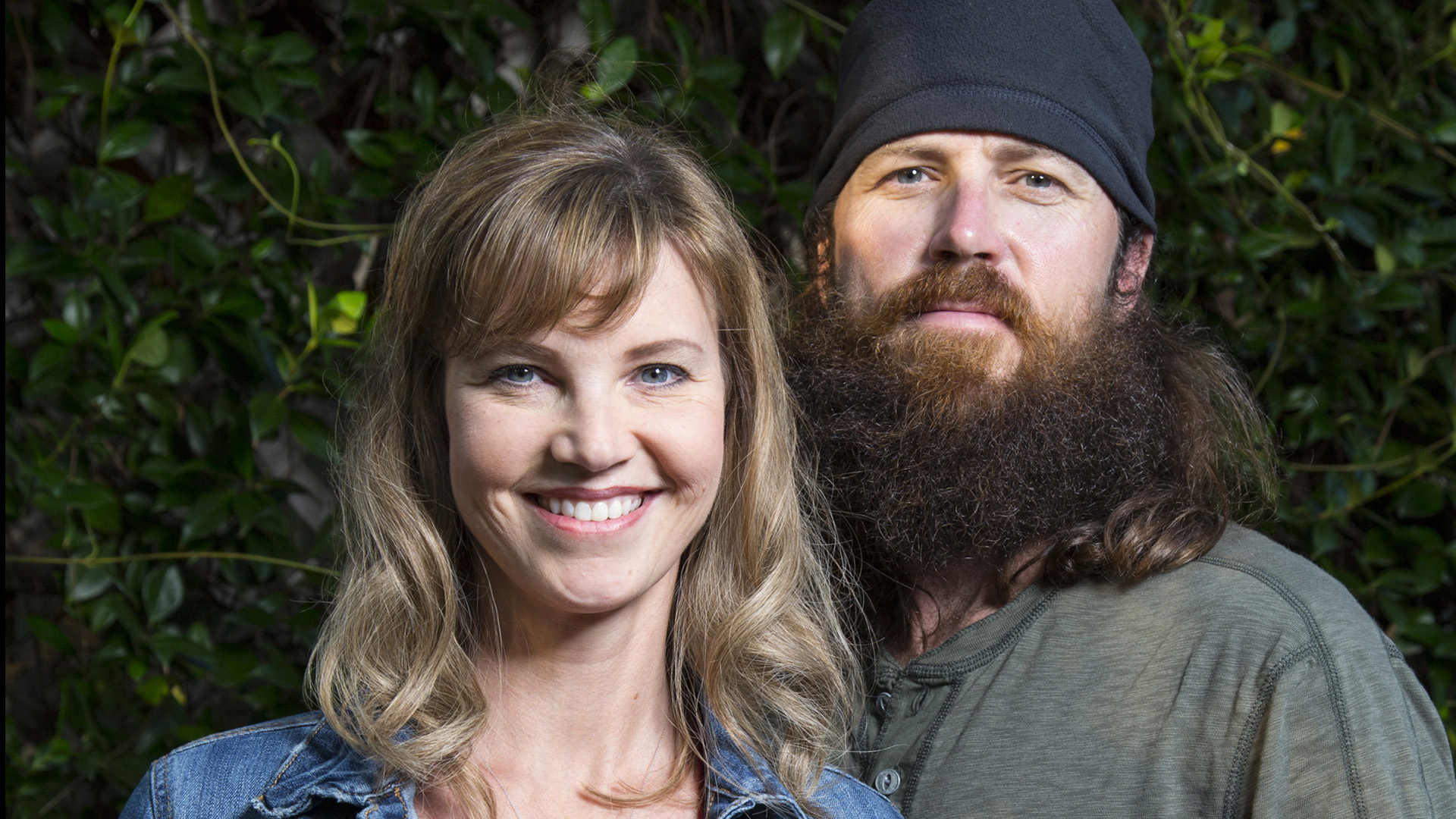Jase and Missy in Duck Dynasty. Jase is wearing a beanie while Jessica is wearing a jean jacket