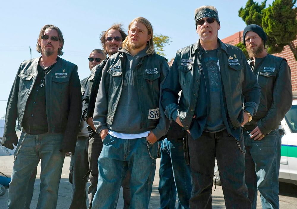 A still of the cast in Sons of Anarchy. The characters are wearing biker cuts