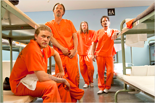 Members of SAMCRO in a prison, they are wearing orange jumpsuits
