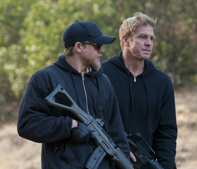 Jax and Kozik, discuss a gunfight strategy, both are holding powerful rifles