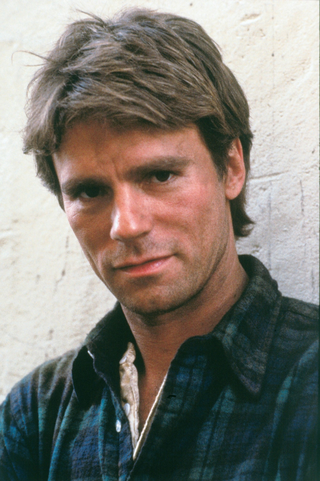 A still of Richard Anderson in his role of Angus MacGyver. He is wearing a green shirt