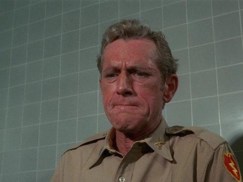 John Anderson is seen wearing a beige Army uniform