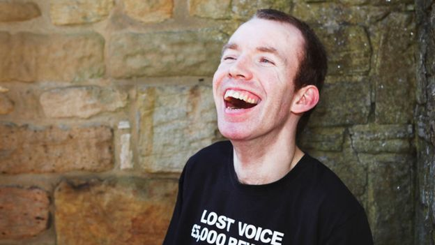 Lee Ridley is wearing a black t-shirt