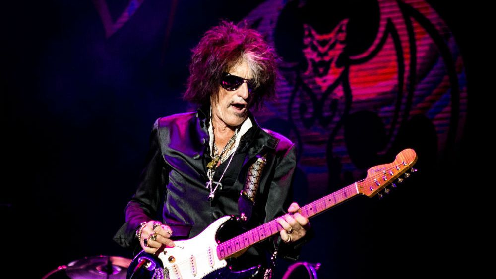 Joe Perry Performing at a stage