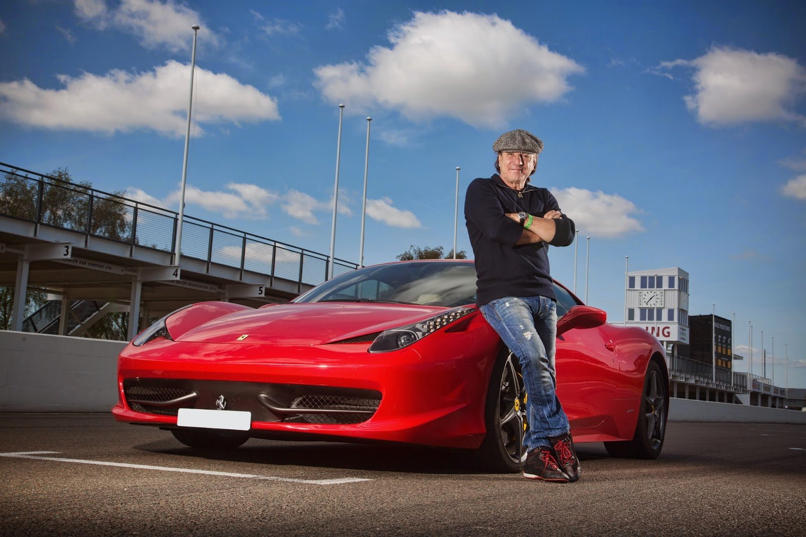 Brian Johnson posing for a picture with his Ferrari 458 Italia
