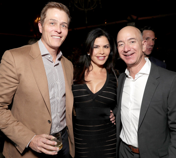 Jeff Bezos Lauren Sanchez and Jake Whitesell smiling for a picture