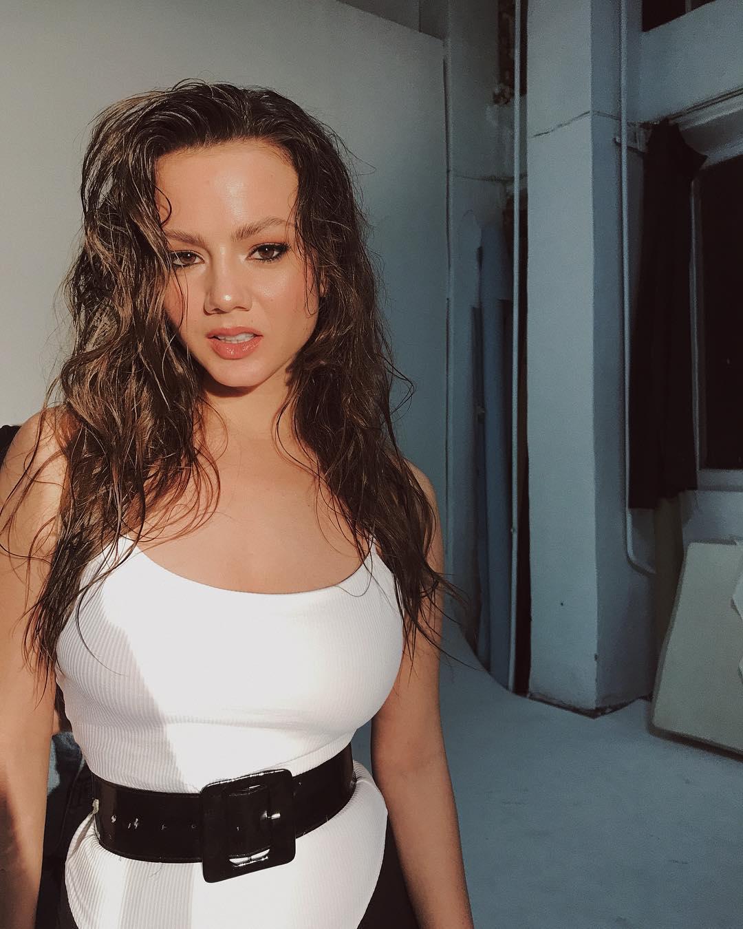 Polina Glen in white top and black shorts