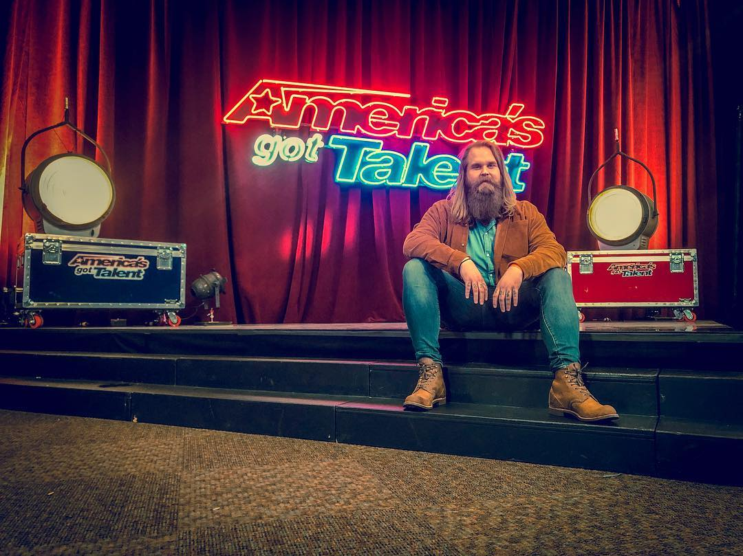 Kris Kläfford posing for a picture on America's Got Talent stage