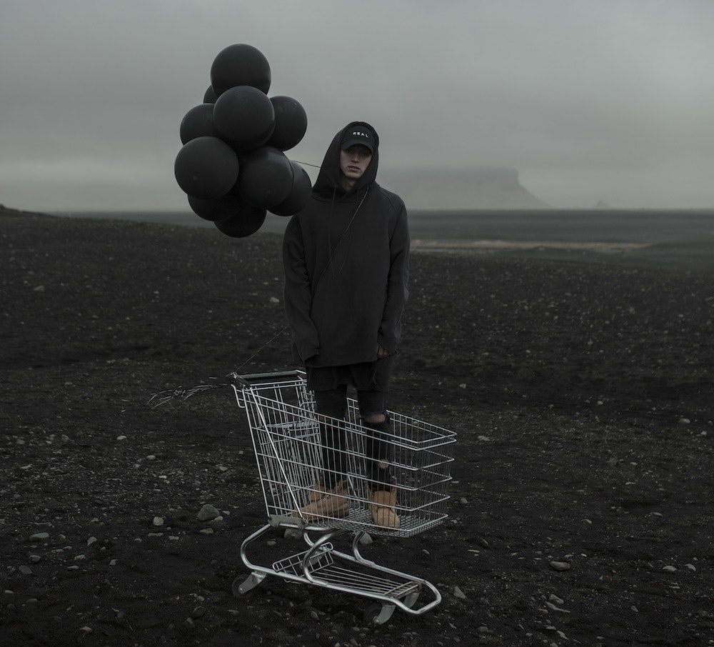 NF with black balloons. American rapper, NF has released five studio albums till now.