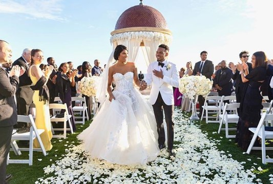 Model Kirsten Corley with husband Chance the Rapper during the wedding ceremony