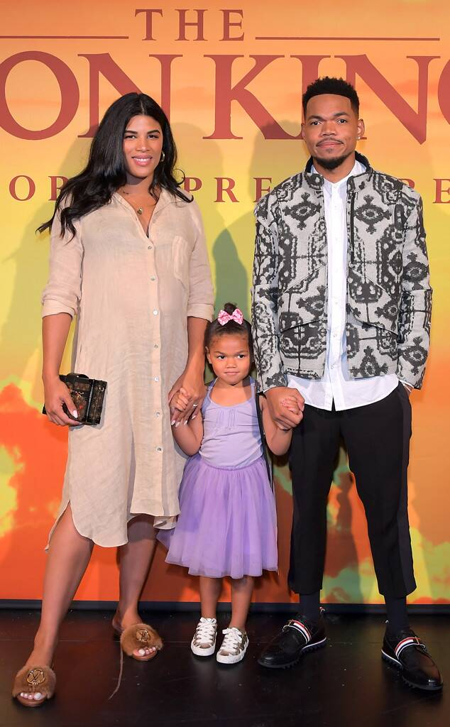 Kirsten Corley and husband Chance the Rapper with eldest daughter Kensli Bennett at The Lion King premiere