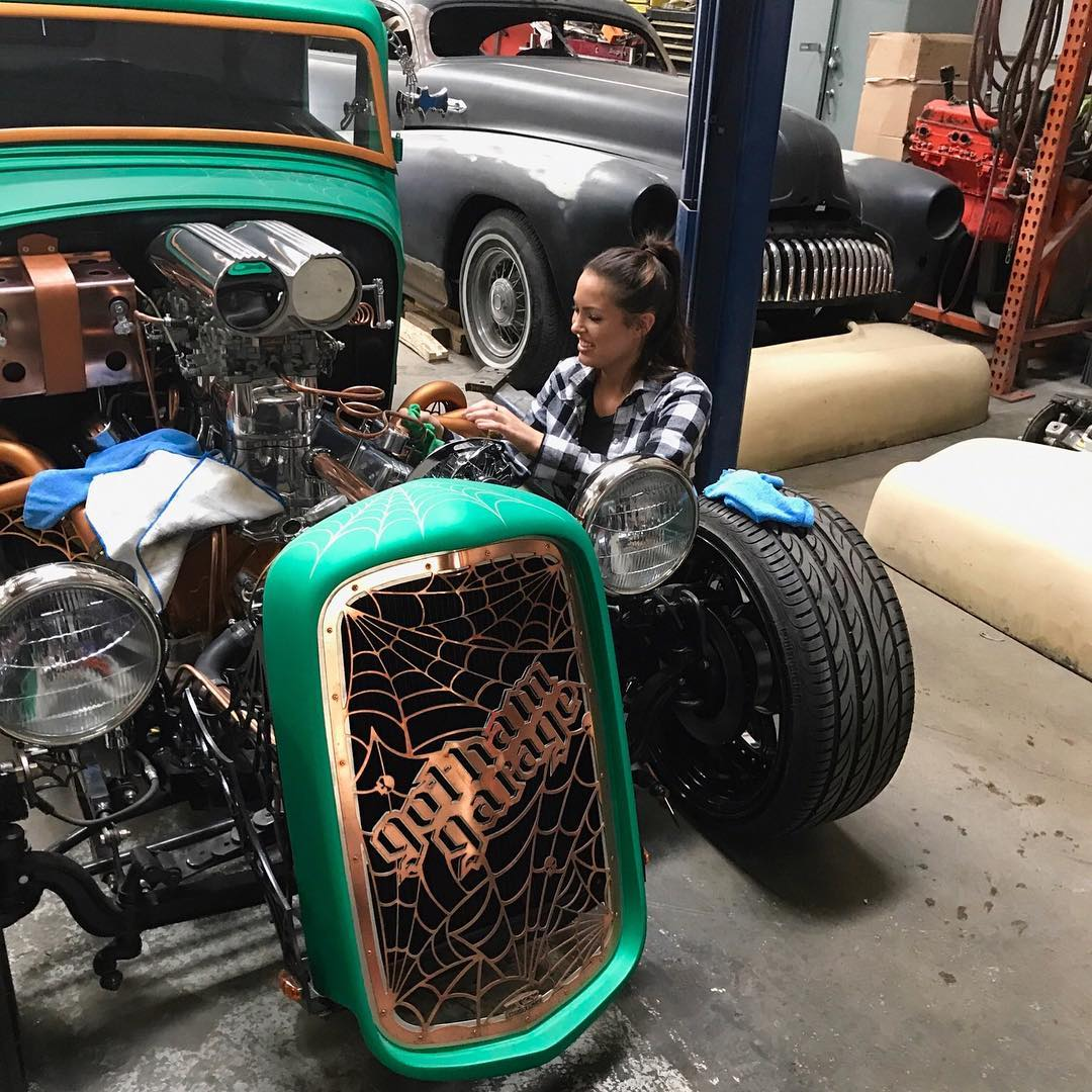 Constance Nunes fixing a hot rod in Gotham Garage. Constance Nunes is best known for appearing in shows like Gotham Garage & Car Masters: Rust to Riches.