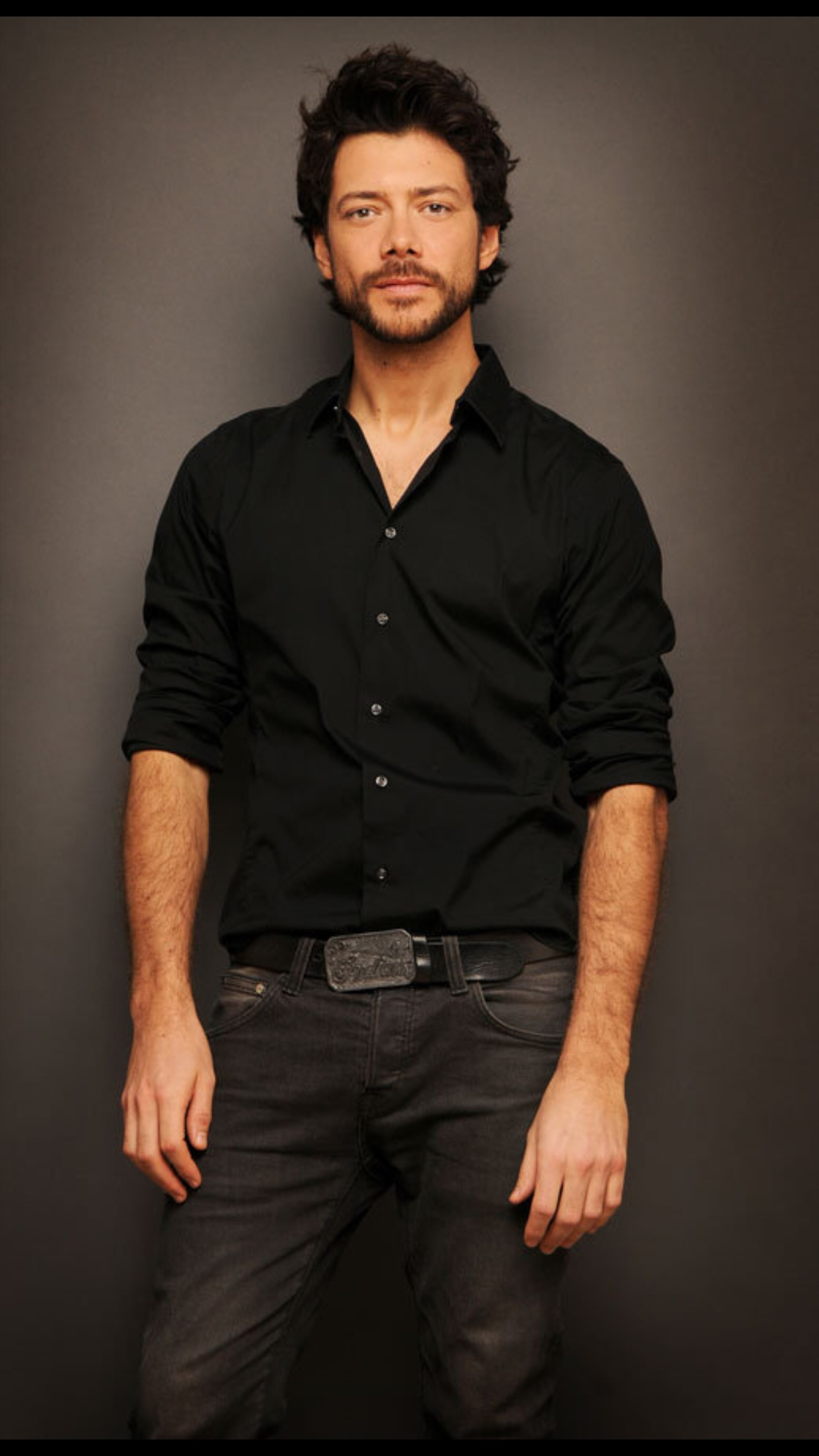 Spanish actor Alvaro Morte in black attire. Alvaro Morte is best known for his performance of El Professor in Spanish drama series Money Heist.