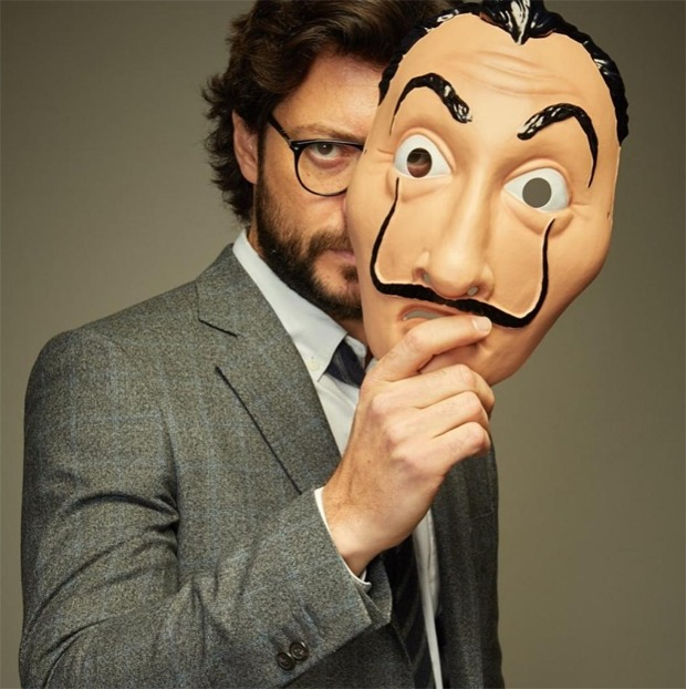 Money Heist star holding a face mask of Salvador Dali. Alvaro Morte plays the role of main protagonist El Professor in Netflix's Money Heist
