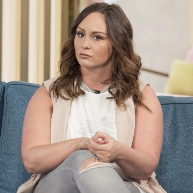 English TV personality, Chanelle Hayes, wears a sleeveless shirt and ripped jeans