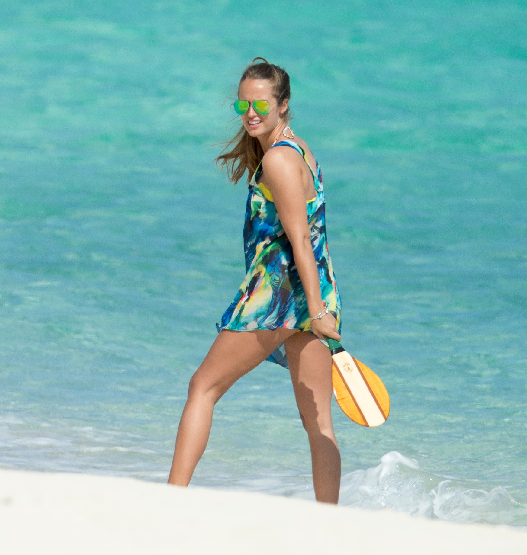 Kim Sears donning tropical printed Ted Baker dress over yellow bikini at a beach in Bahamas in 2013
