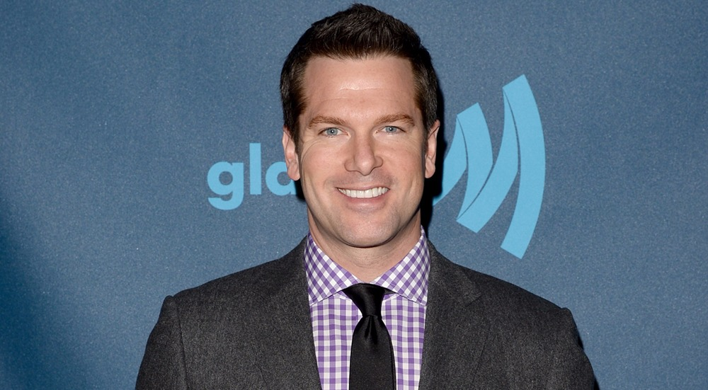Thomas Roberts posing for a picture in VIP Red Carpet Suite at GLAAD Media Awards 2013
