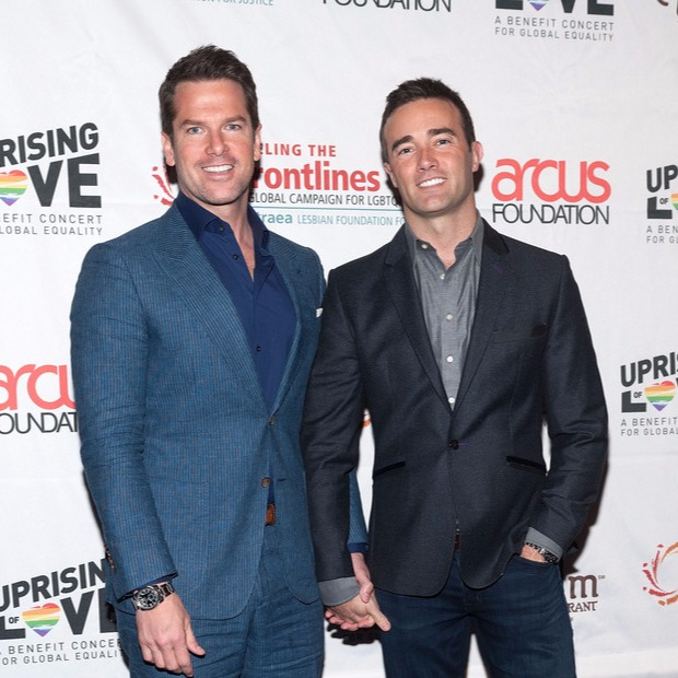 Thomas Roberts and husband Patrick D. Abner clasping hands at Uprising of Love: A Benefit Concert  for Global Equality in NYC in 2014