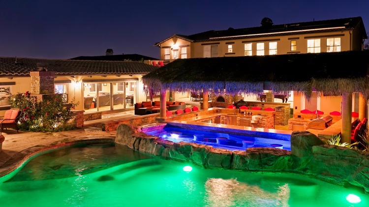 Alfonso Ribeiro's Granada Hills house also consists of a party-ready space and swimming pool with a spa and a grotto