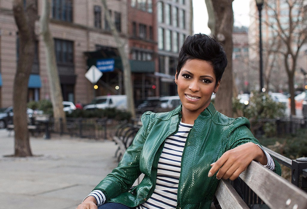 Tamron Hall posing for the camera on a park bench