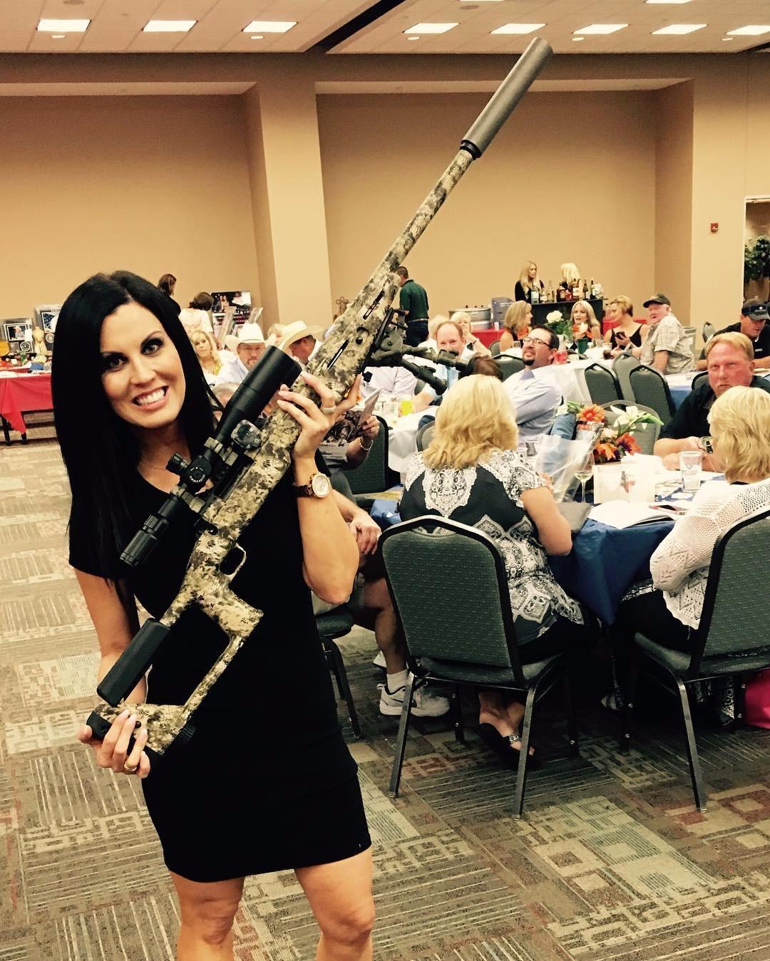 Jennifer Brennan holding a gun in an Instagram Picture