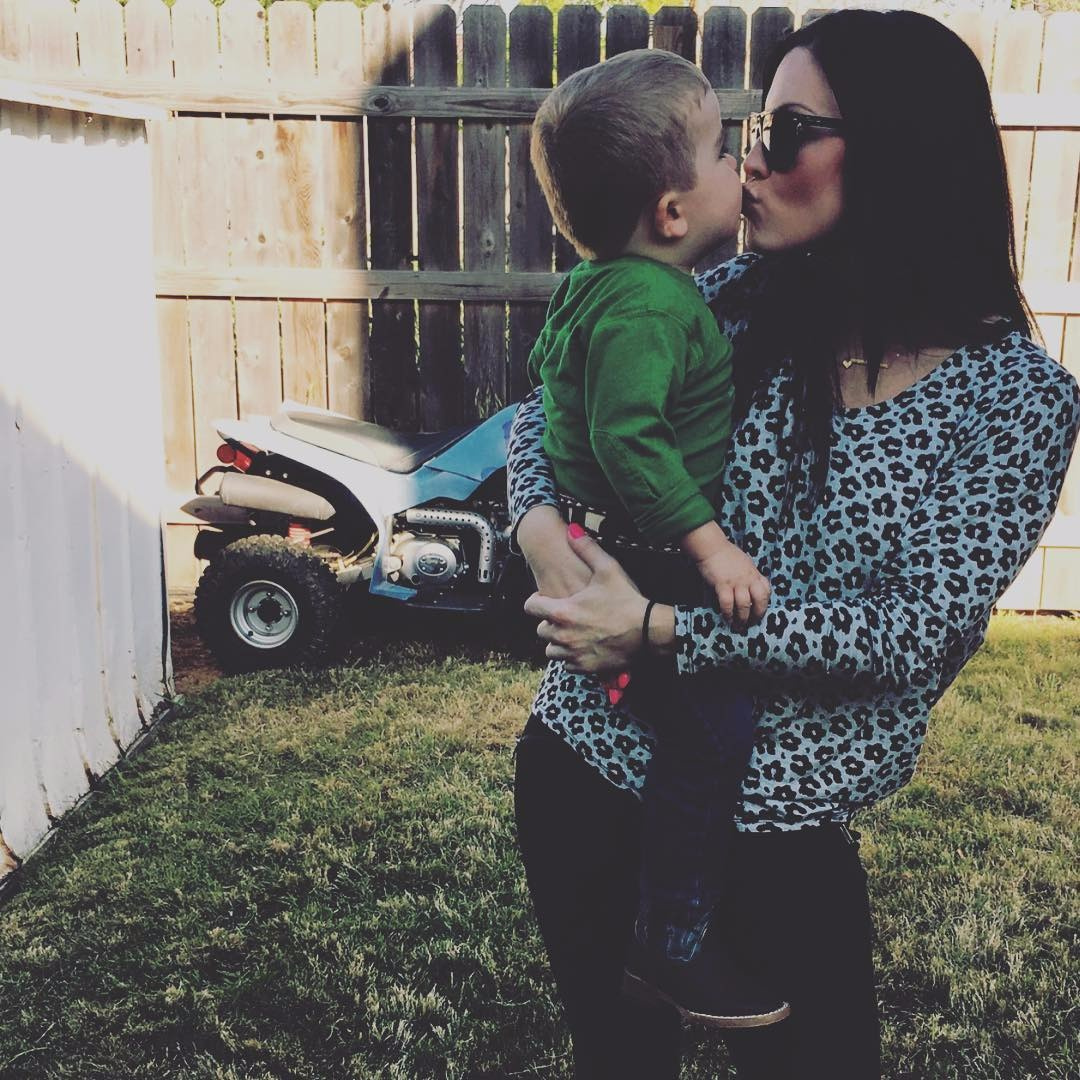 Jennifer Brennan kissing her son Brennan Grey Foster