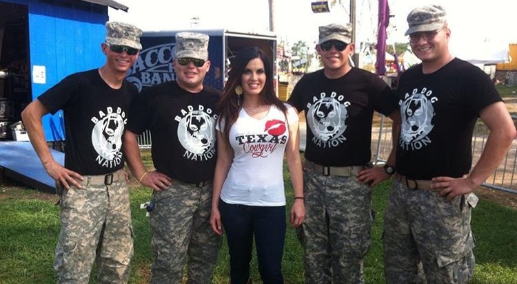 Jennifer Brennan poses for a picture with Bad Dog Nation cadets