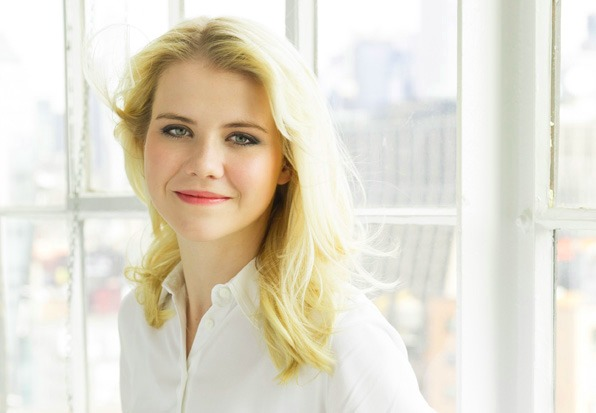 Elizabeth Smart looks beautiful in the white dress. She is looking at the camera and with a smile on her face.