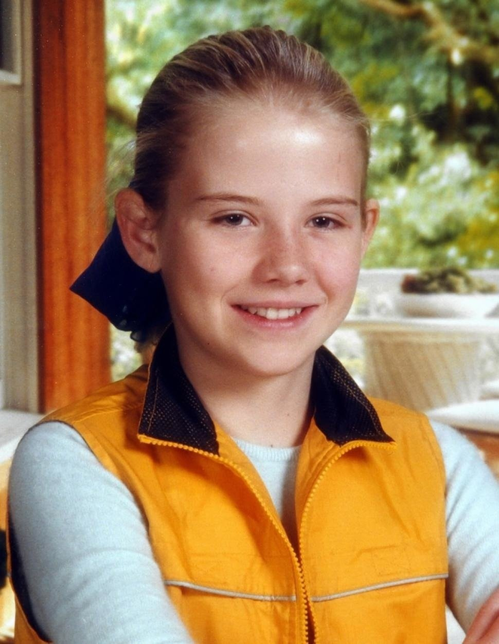 Elizabeth Smart is wearing t-shirt and yellow half jacket. She is looking at the camera with a smile on her face. She was kidnapped when she was just 14 at age.