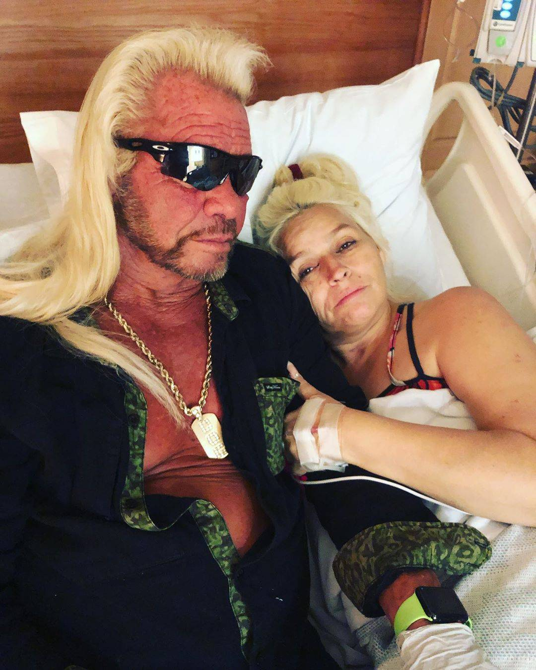 Duane Chapman lying next to Beth in a hospital bed