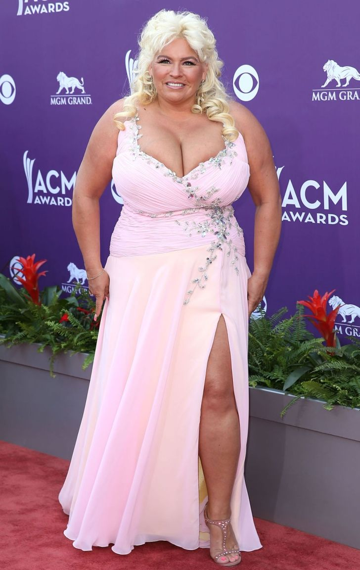 Beth Chapman posing for photo wearing a white dress. She became a bails bondwoman at the age of 29.