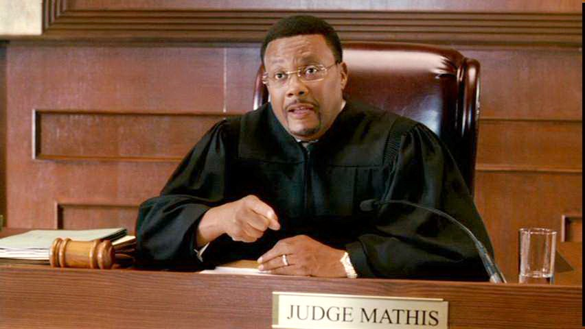 Greg Mathis on judge's chair on his show Judge Mathis