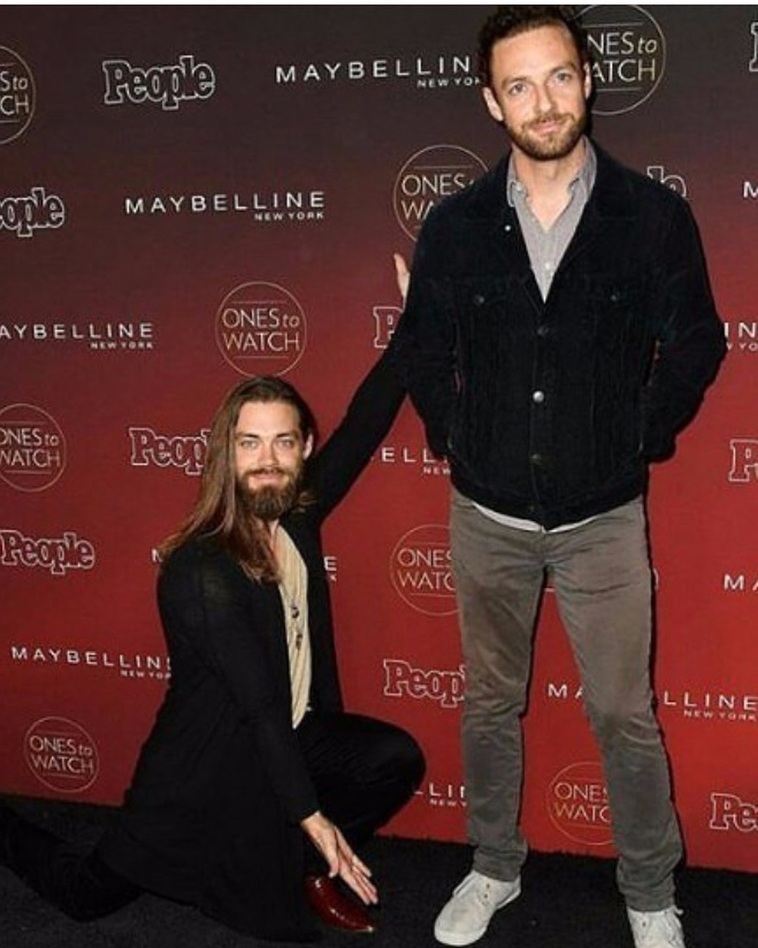 Ross Marquand and Tom Payne showing of their bromance chemistry. Payne uses his hands' gesture as if like he is presenting Ross Marquand in front of the camera at the People's event.