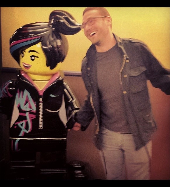 Ross Marquand posing with a statue of Wyldstyle from The Lego Movie. He captioned the photo as  'Hanging out with my new girlfriend...she's hilarious.'