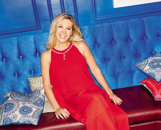 Chelsy Davy sitting, there are a few cusions around her