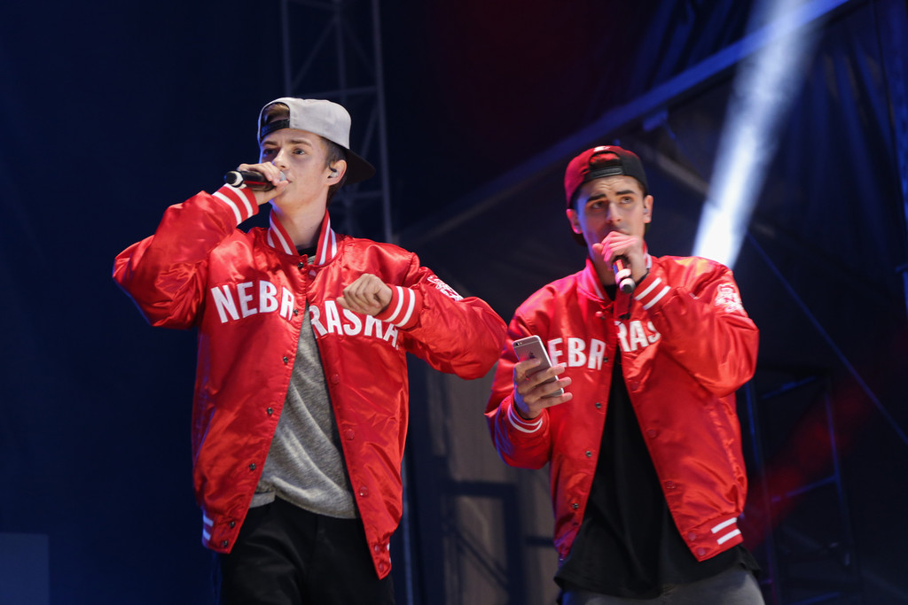 Jack Gilinksy and Jack Johnson both wearing red jacket with caps and are seen holding mics