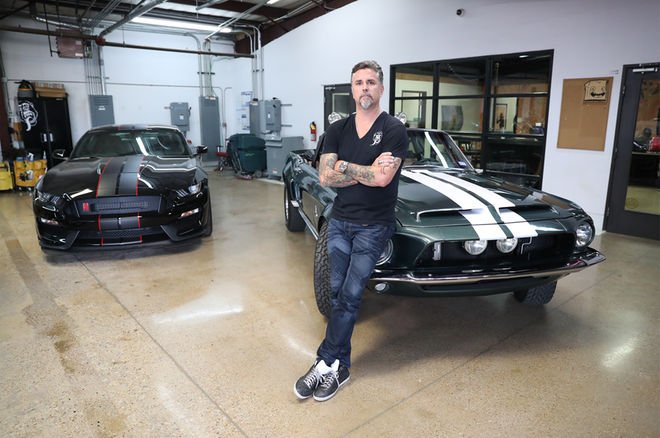 Richard Rawlings standing with his 1968 Ford Mustang and Shelby GT350 convertible
