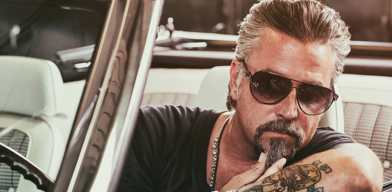 Richard Rawlings in a sun glass posing for a picture.