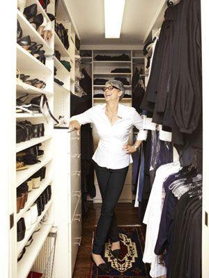 Jamie Lee Curtis looking smart in her short hair, she is standing tall in between her wardrobe.