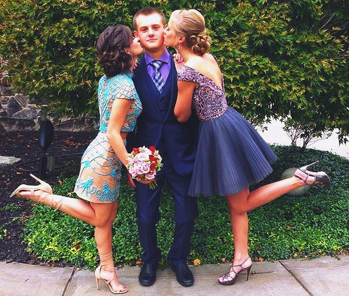 Brooke Hyland and Paige Hyland kissing their brother Josh Hyland